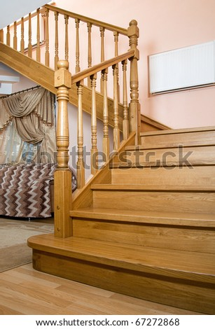 Ladder from an oak the leader on the top floor of the house. - stock photo