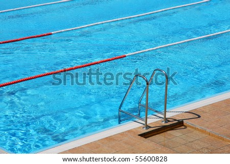 Ladder of a swimming pool - stock photo