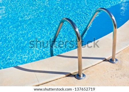 Ladder of a swimming pool. Horizontal shot - stock photo