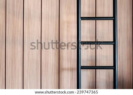 Ladder on wooden background - stock photo