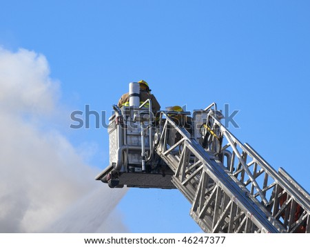 Ladder truck with firefighter - stock photo