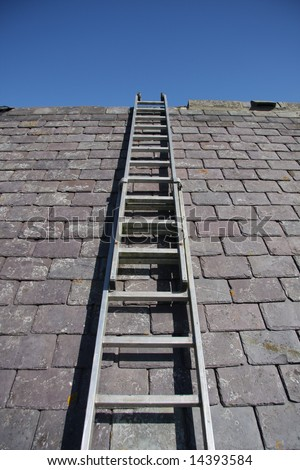 Ladder which takes the roofer up to the top - stock photo