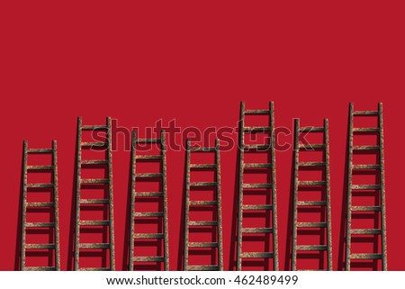 Ladders on red wall ,competition concept