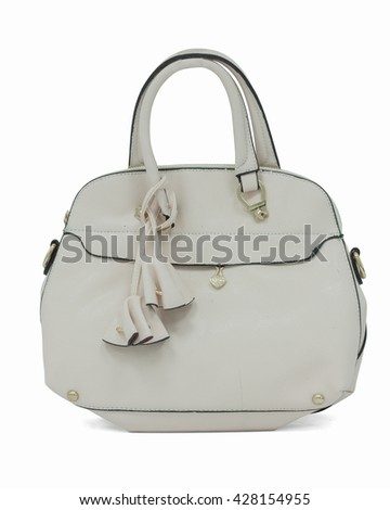 Ladies' cream colored handbag on white background