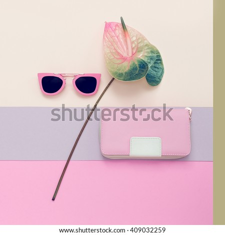 Ladies Fashion Accessories. Pink Clutch and sunglasses. Pastel colors Trend - stock photo
