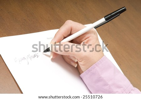 ladies hand writing up meeting minutes at work