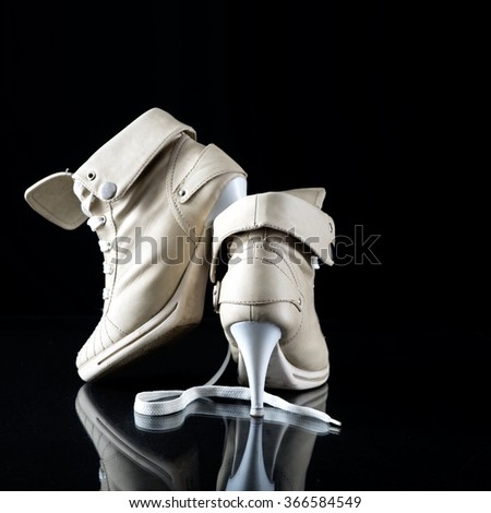 Ladies high heels winter boots on black backgrounds - stock photo