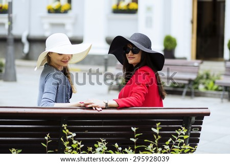 Ladies on a bench flirt with photograph - stock photo