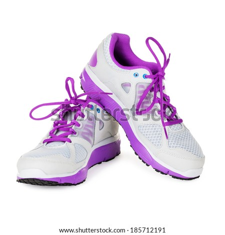 Ladies pink sneakers on a white background - stock photo