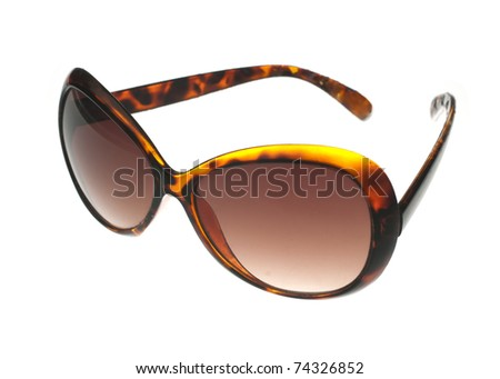 Ladies sunglasses at angle on a white background - stock photo