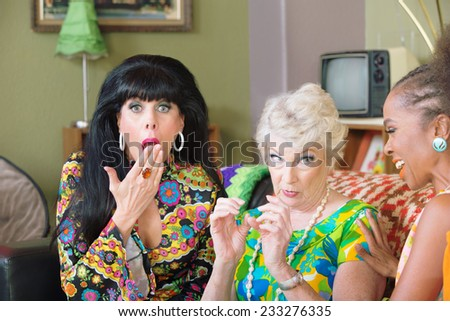 Ladies talking about funny things and being embarrassed - stock photo