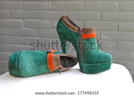 Ladies the green suede shoes on a heel and platform - stock photo