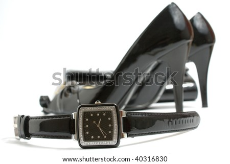 Ladies' watch, high heels shoes and handbag on white - stock photo