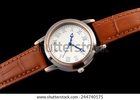 Ladies' watch isolated on black - stock photo