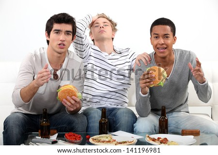 Lads watching television - stock photo