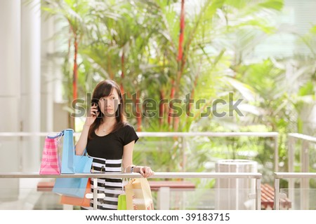 Lady Airport Shopping on Holiday in Her Travels - stock photo