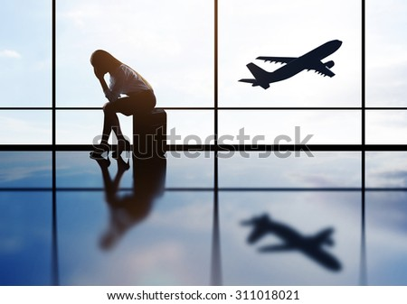 Lady and airport - stock photo