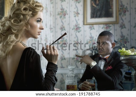 Lady and gentleman flirt in hotel's apartment - stock photo