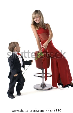 Lady and gentleman. Young mother in a red dress and the little boy in a suit - stock photo