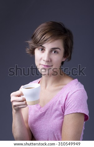 Lady and her coffee. - stock photo