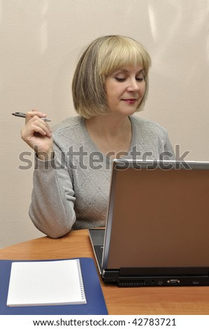 Lady at the moment of creating activity with laptop at the office table. - stock photo