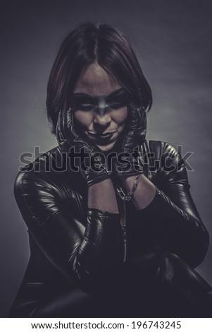 lady, brunette girl dressed in black latex jumpsuit - stock photo