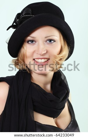 lady charming with black hat over light background