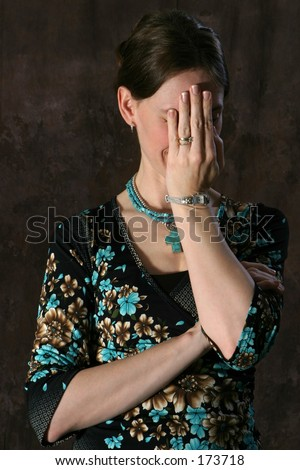 Lady covering face - stock photo