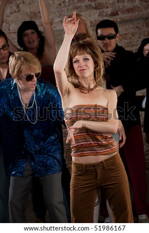 Lady Dancing in a crowd at a 1970s Disco Music Party - stock photo
