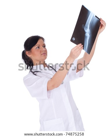 lady doctor in white uniform looking at x-ray