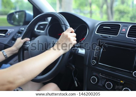lady drive the car casually - stock photo
