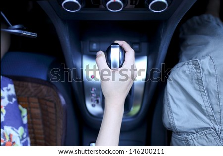 lady drive the car her hand push gearbox - stock photo