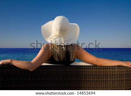 Lady enjoying a perfect view to the ocean - stock photo