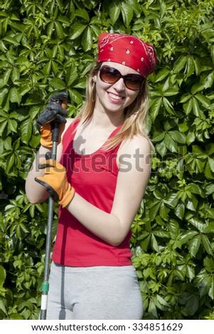 Lady gardner watering  - stock photo
