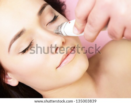 electrostimulation lifting therapy, beautiful face of young woman ...