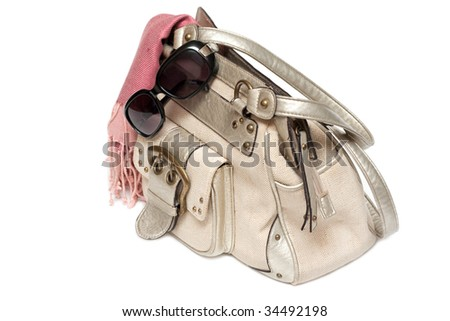 Lady hand-bag in rose charge and sun-protective spectacles - stock photo