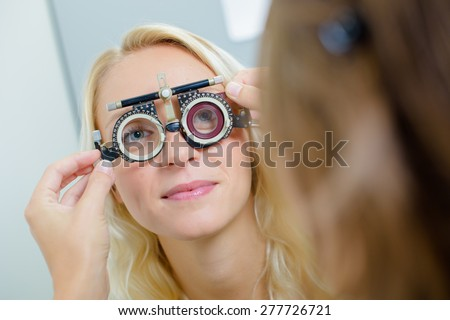 lady having eye examination - stock photo