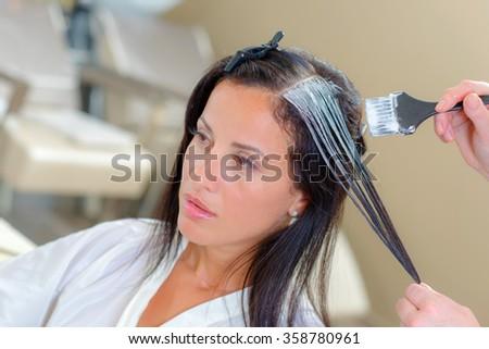 Lady having hair dyed - stock photo