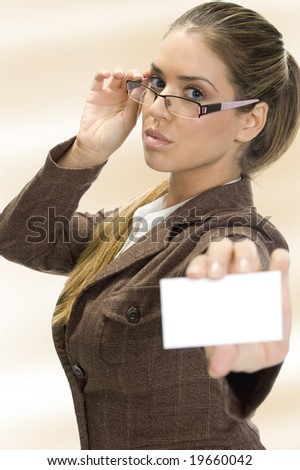 lady holding  business card on an isolated white background - stock photo