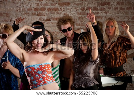 Lady in a beret dancing at a 1970s Disco Music Party - stock photo