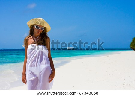 Lady in a bikini on a tropical beach - stock photo