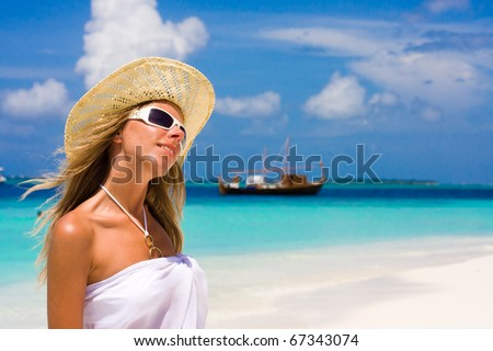 Lady in a bikini on a tropical beach