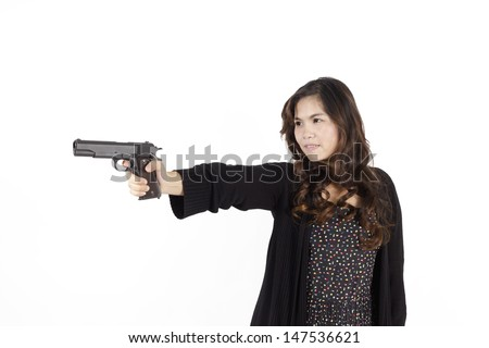 Lady in action pose as she aims a weapon through site.  Isolated against white background. - stock photo
