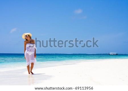 Lady in bikini on a tropical beach - stock photo