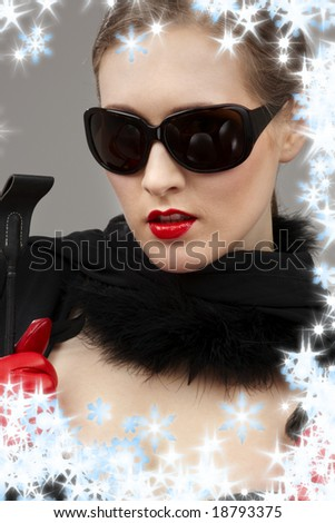 lady in black dress and red gloves with crop - stock photo