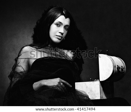 Lady in black with coffer, XIX centure style, monochrome