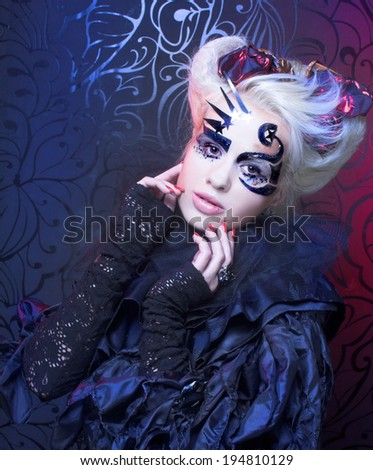 Lady in black. Young woman in creative halloween image. - stock photo