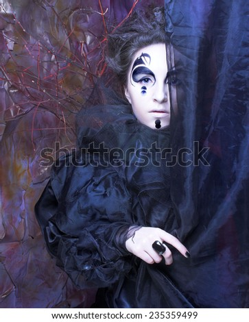 Lady in black. Young woman in dark creative image.  - stock photo
