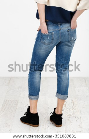 Lady in jeans clothes on the white background