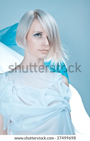 Lady in light blue toga